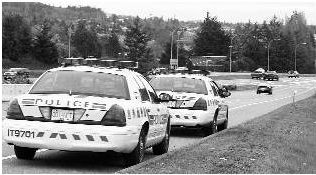 Police cars parked on the shoulder. Photo credit: Bruce Stotesbury, Times Colonist